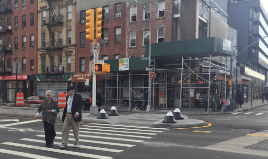 Expanded medians at East Houston Street and First Avenue make for safer crossings for pedestrians. Photo: David Meyer