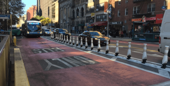 """Flexible bollards"" at Sixth Avenue aim to keep motorists out of buses way. Photo: David Meyer"