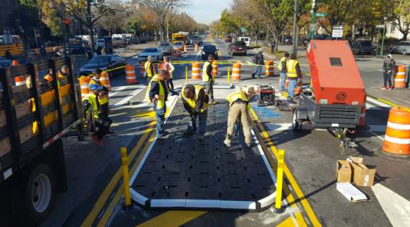 DOT crews began installing removable plastic pedestrian islands on Eastern Parkway yesterday. Photo: DOT