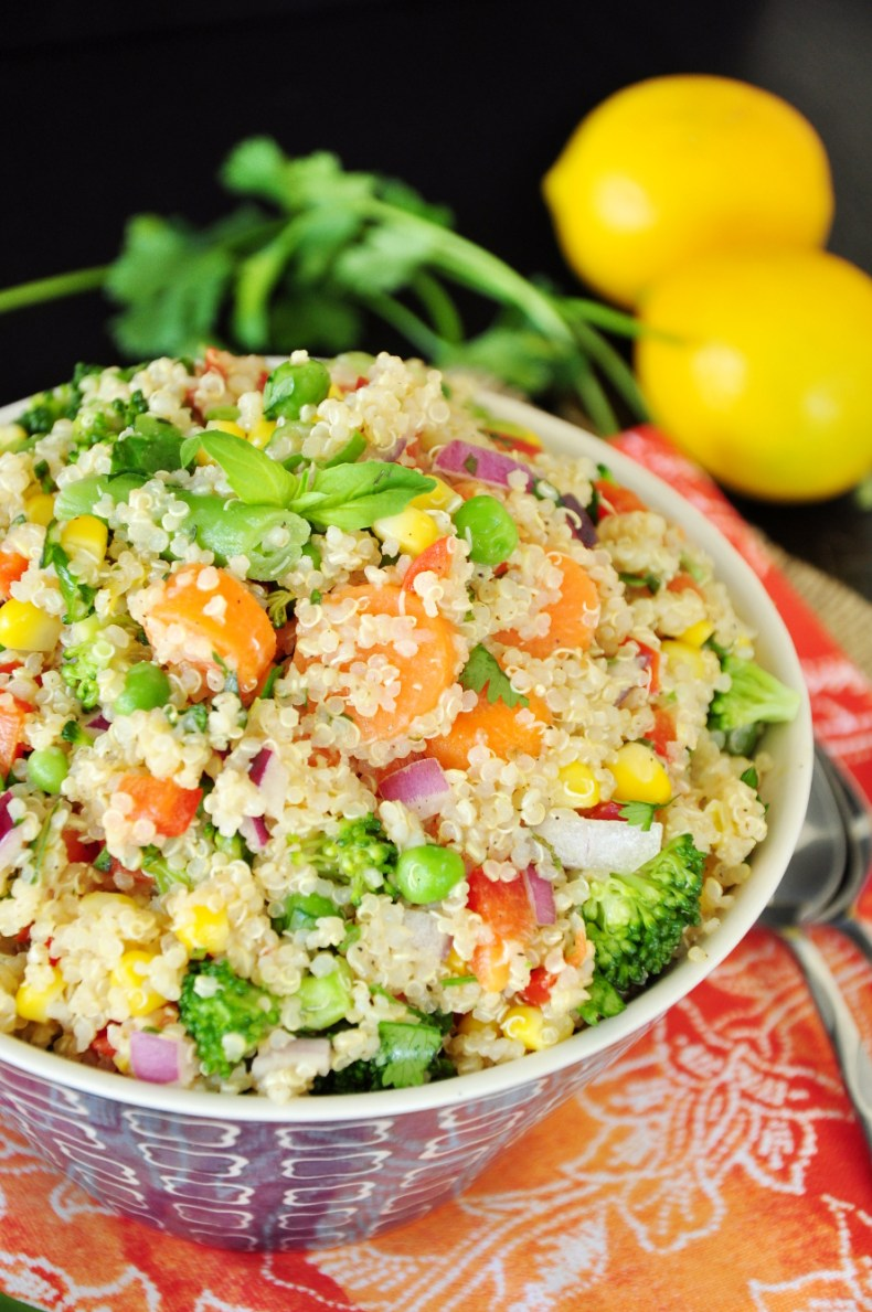 Packed with a variety of vegetables and herbs along with a simple & delicious lemon Dijon dressing, this vegan quinoa bowl is rich in flavor and nutrients.