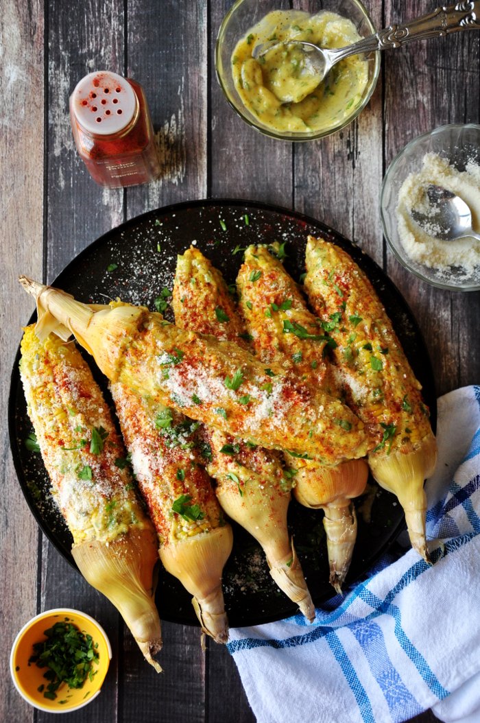 Roasted corn on the cob coated w/ homemade aioli, paprika, Parmesan cheese and parsley, this Caribbean-style corn will change the way you eat corn forever.