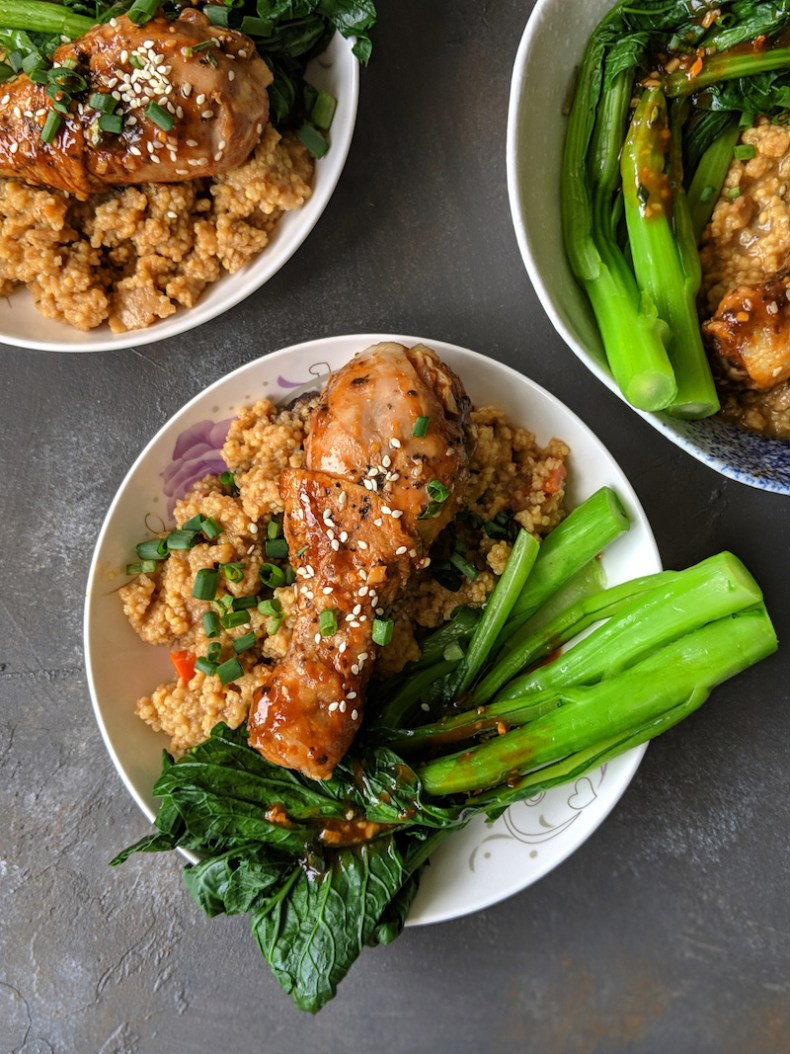 Spicy and sticky chicken drumsticks with Chinese kale and millet