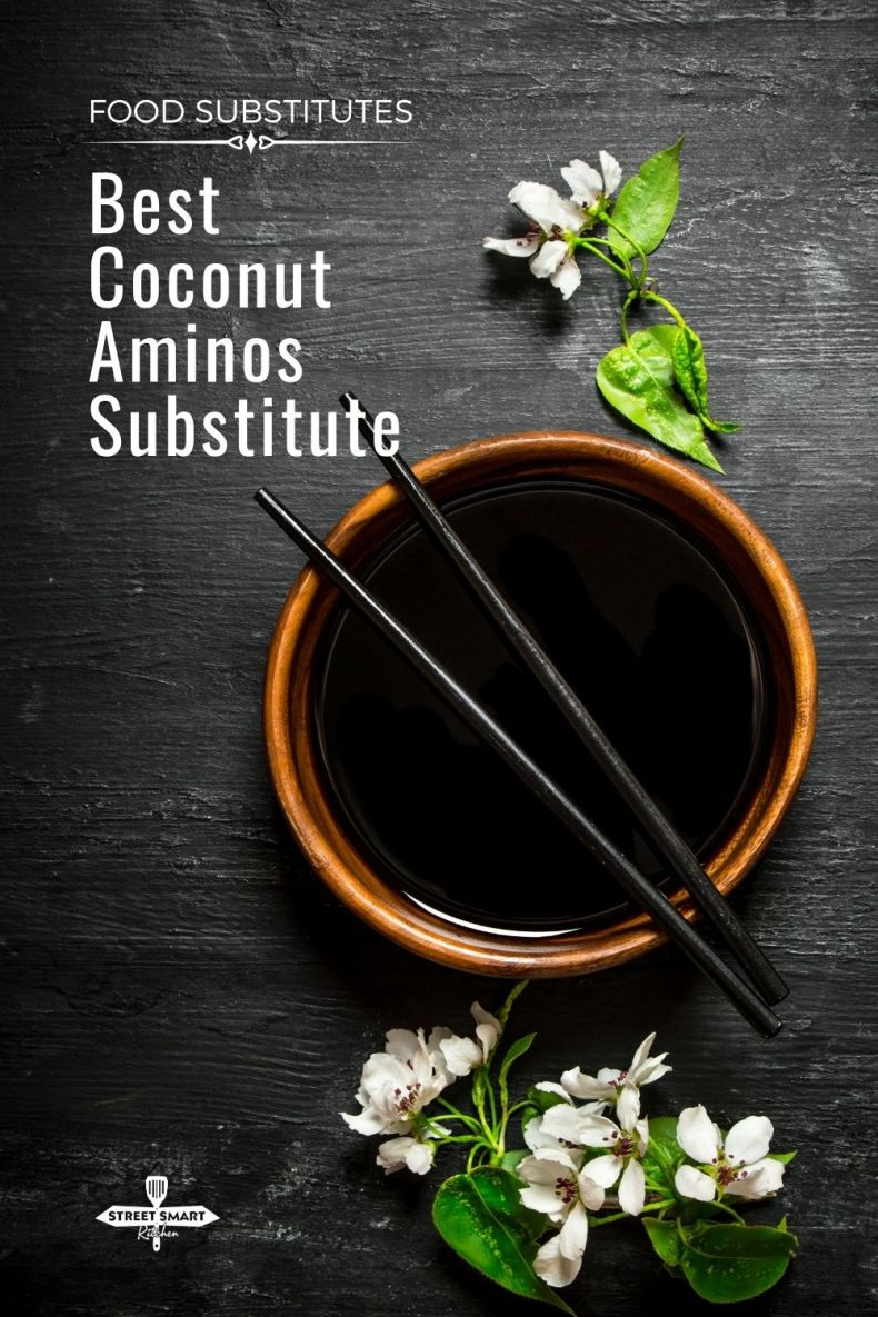 coconut aminos in a bowl with chopsticks and flowers