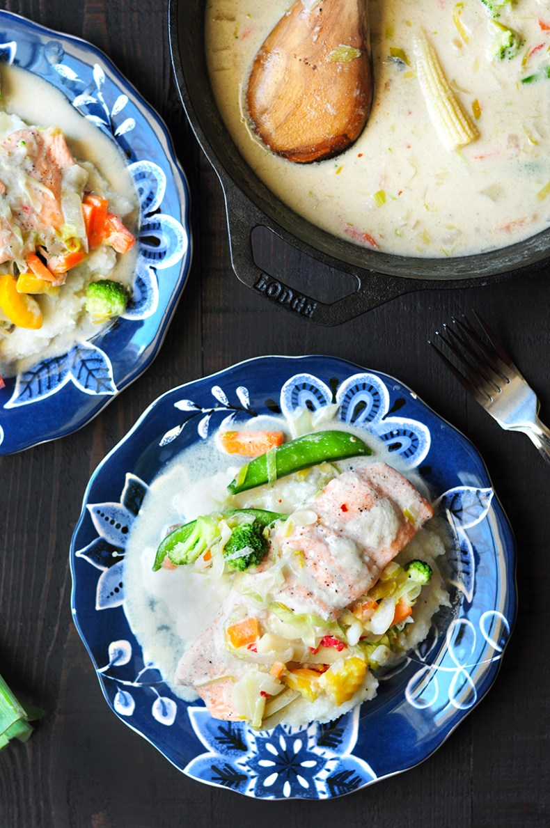 A delightful poached salmon recipe featuring a healthy protein and sides to give you a satisfying, complete meal for a family of four.