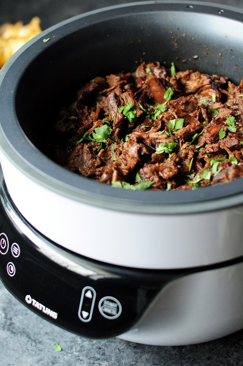 Extremely tender barbacoa recipe made with a savory chipotle sauce. This Fusion Cooker beef recipe only takes 5 mins of hands-on time and let the Fusion Cooker do the rest!