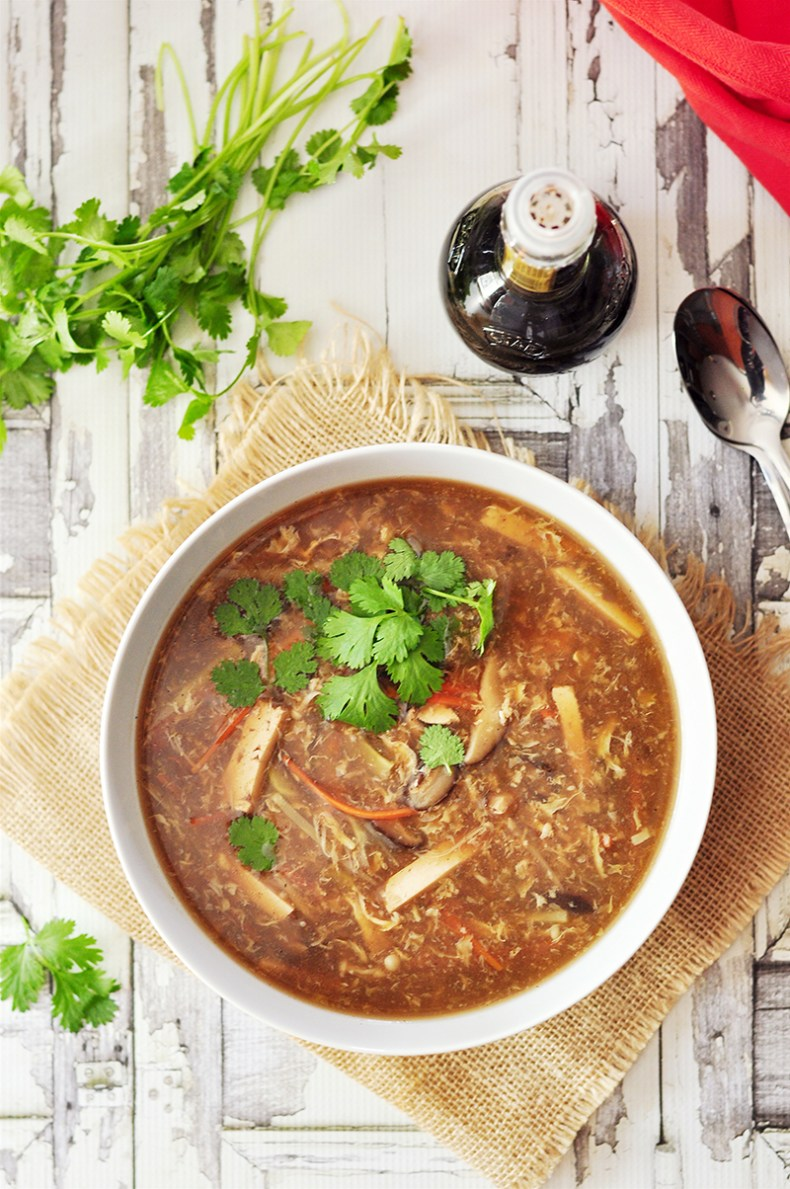 Authentic Chinese gluten-free hot and sour soup with loads of vegetables, tofu and an egg cooked in a rich chicken broth or vegetable broth. The flavor is enhanced by balsamic vinegar, tiny little bit of brown sugar and a decent amount of ground black peppers.