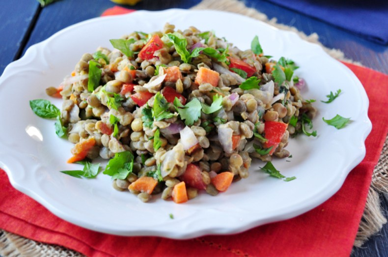 This is a delicious lentil salad that's wonderful when served as a side as well as nutritiously satisfying when served as a main. This recipe makes a huge batch because we'd suggest you consider making it ahead of time as a side dish to pair with your meat or seafood throughout the week.