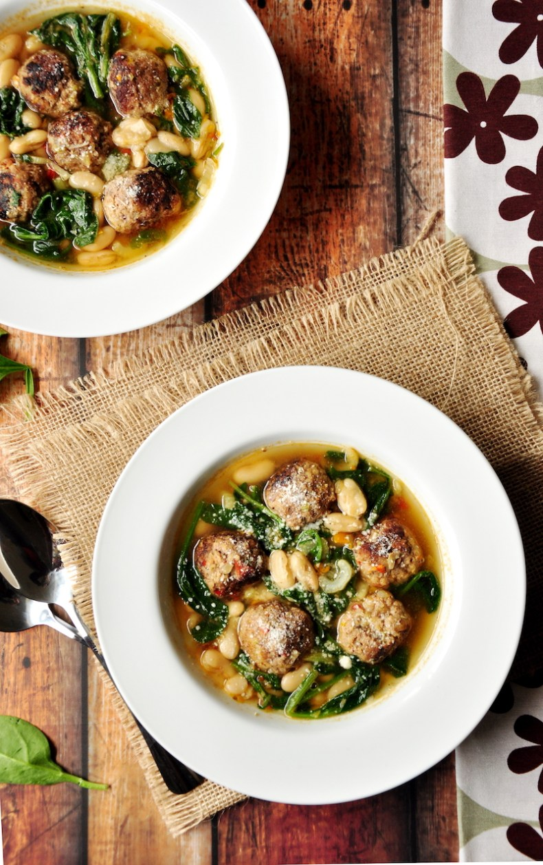 A simple twist on a classic Italian meatball soup: this hearty soup recipe features easy-to-make meatballs, vegetables, cannelloni beans, and spinach, simmered in a collagen-rich beef bone broth.
