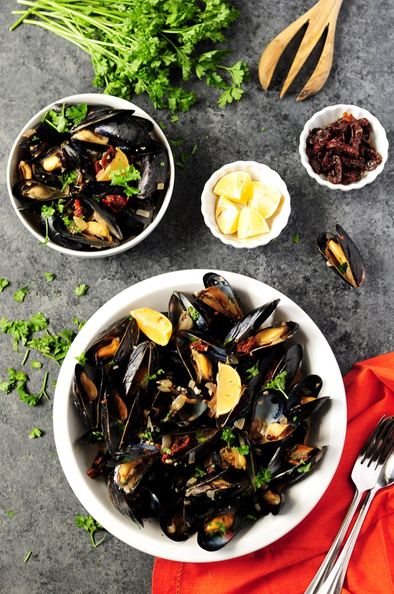 Super easy mussel recipe steamed in white wine and flavor-rich chicken bone broth. Serve it as an amazing appetizer or over spaghetti as an elegant dinner.