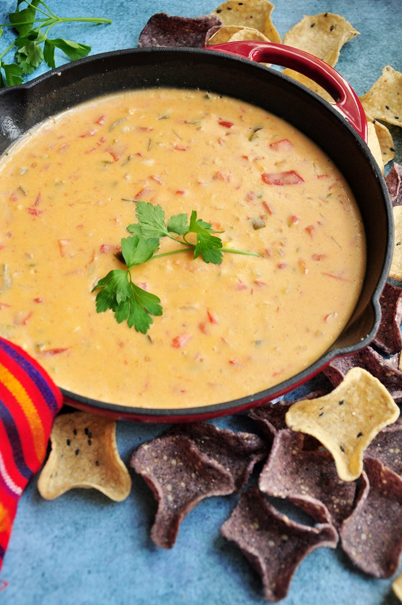 Ten ingredients and 20 minutes are all you need for this velvety, rich, and dangerously addictive Tex-Mex Chili Con Queso recipe. It's also gluten-free.