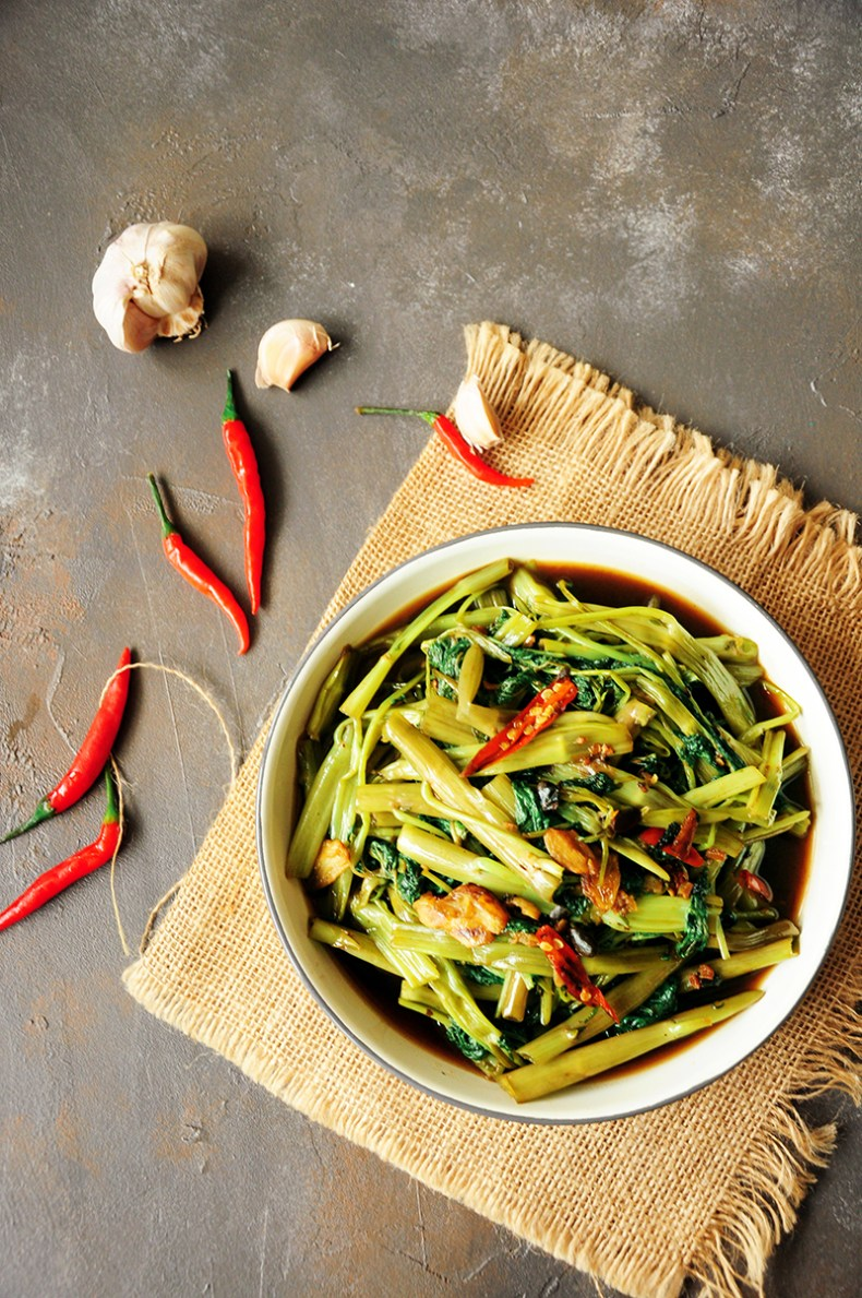 Cook one of the most popular Thai dishes at home with this tasty stir-fry morning glory (water spinach recipe.) It's super quick and vegan-friendly.