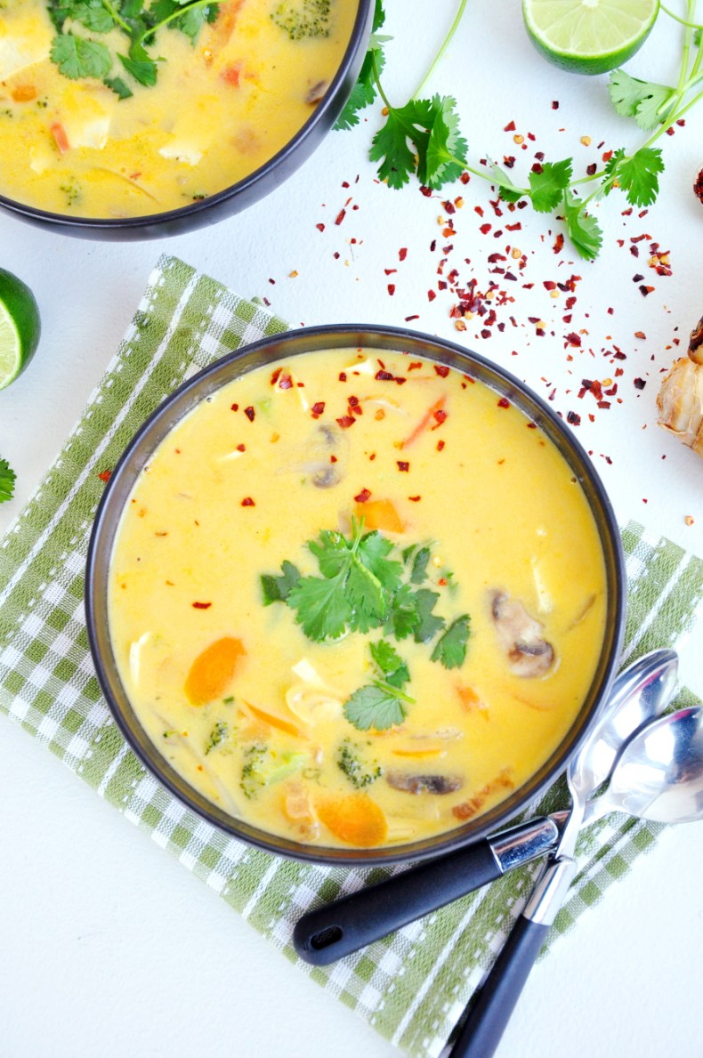 A light Thai vegetable soup recipe, flavored with authentic herbs along with hearty vegetables, coconut milk, and tofu. It's vegan and gluten-free friendly.