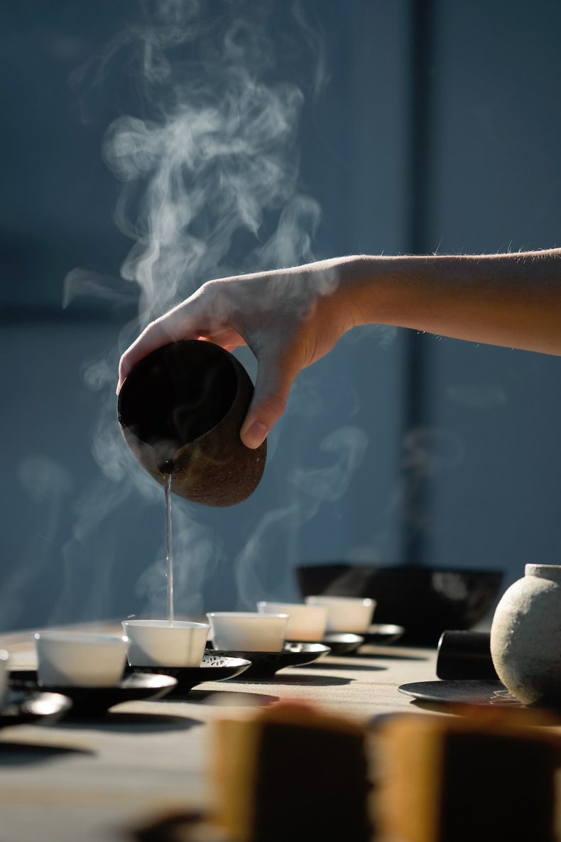 does tea expire? - pouring hot water into a tea cup