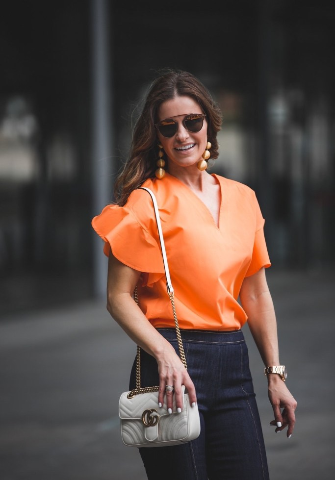 My RewardStyle Conference Looks// Dallas Style Blogger// MDS Stripes Flutter Sleeve Orange Top// Cinq a Sept Flare Jeans// Marion Parke Platform Sandals// Rebecca de Ravenel earrings// Gucci Marmont matelassé shoulder bag//
