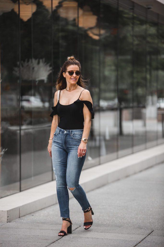 LPA Black Bodysuit | Mother Stunner Ripped Jeans | Gucci Handbag | Dior Sunglasses | Marion Parke Black Sandals | Eddie Borgo Gold Choker