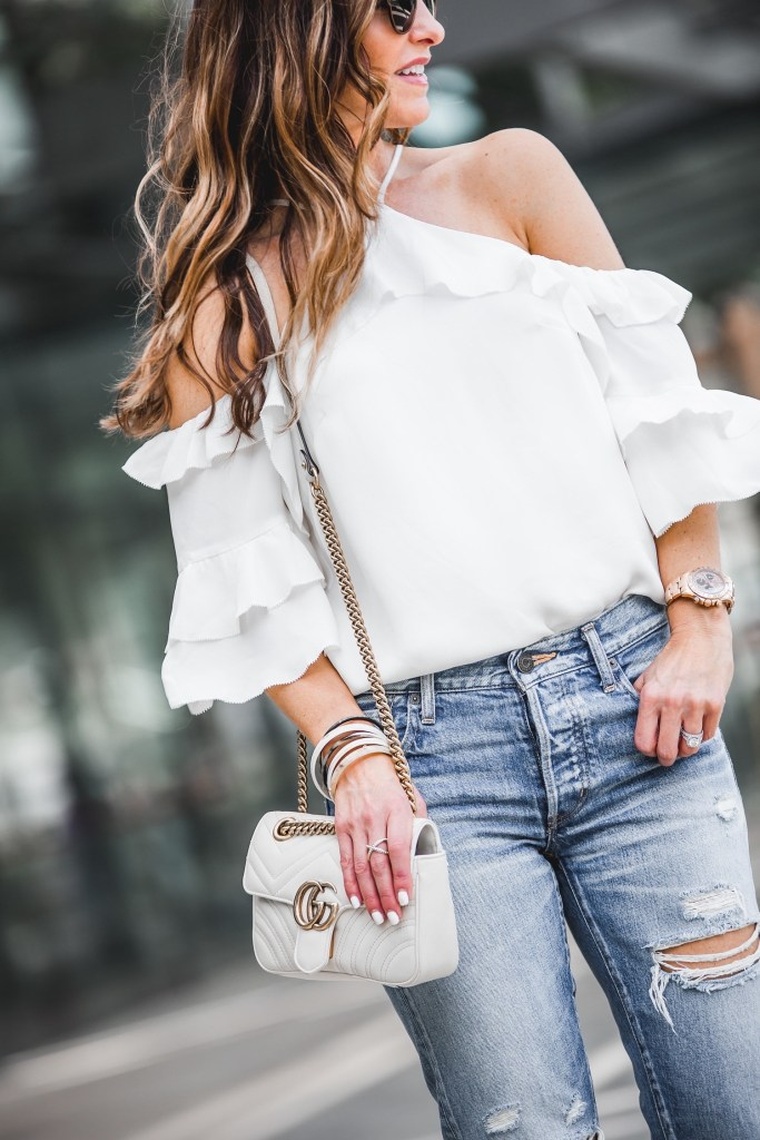 Parker Ruffled Cold-Shoulder Silk Blouse || MOUSSY Bowie Tapered Jeans || Gucci GG Matelassé Shoulder Bag || Dior So Real Brow Bar Sunglasses || Nicola Bathie Designs Bracelet