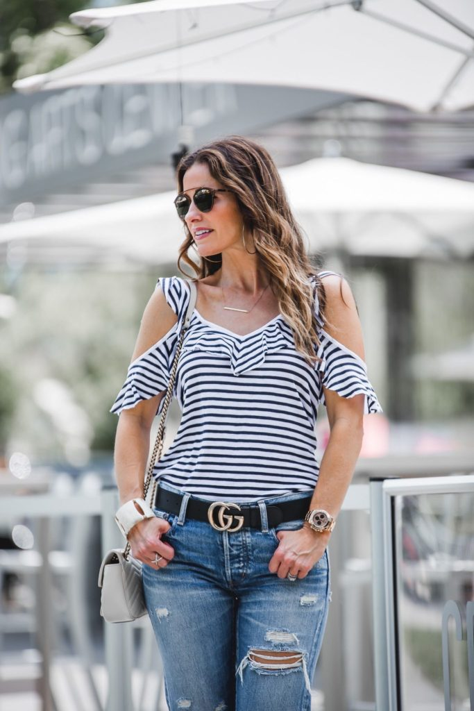 Splendid French Striped Cold-Shoulder Ruffled Tee// MOUSSY MV Bowie Tapered Jeans// Gorjana Taner Extra Large Hoop Earrings// Jennifer Zeuner Chelsea Horizontal Bar Necklace// LAGOS Enso Caviar Crossover Ring// Harper Hallam Bracelet// Dior So Real Round Brow Bar Sunglasses//