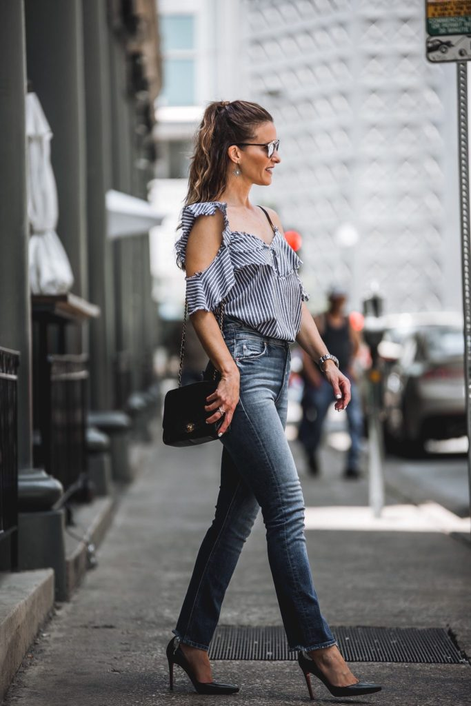 Sam & Lavi Striped, Ruffled Blouse// Mother Dazzler Shift Jeans// Dior So Real Round Sunglasses// Chanel Boybag// LAGOS Caviar Crossover Ring// Harper Hallam Earrings// Christian Louboutin Black Pumps//