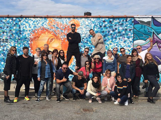 tour group in front of street art
