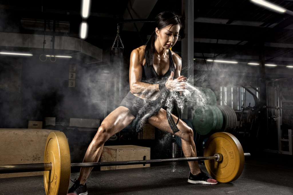 Woman training deadlifts