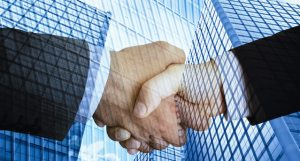 Business People Shaking Hands over the due diligence process