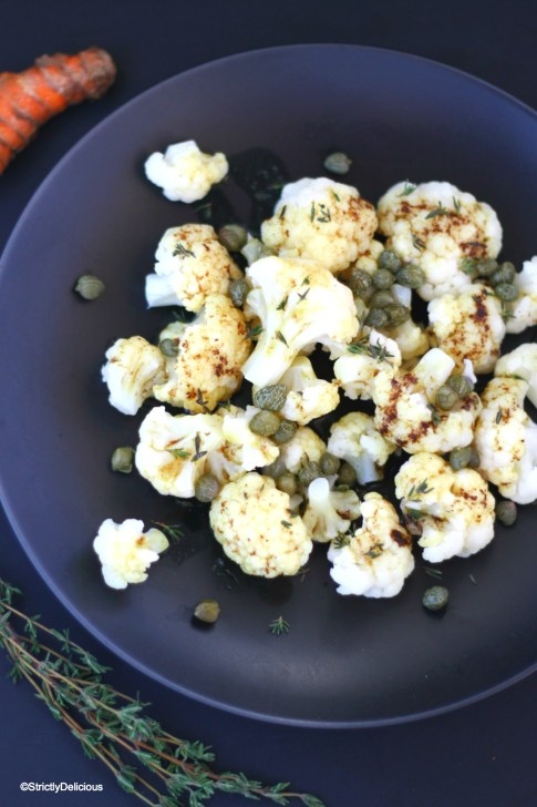 Boiled Cauliflower with Turmeric Thyme Browned Butter & Capers | StrictlyDelicious.com