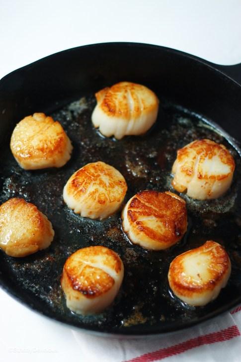 Seared Sea Scallops over Arugula with White Wine Garlic Sauce | StrictlyDelicious.com