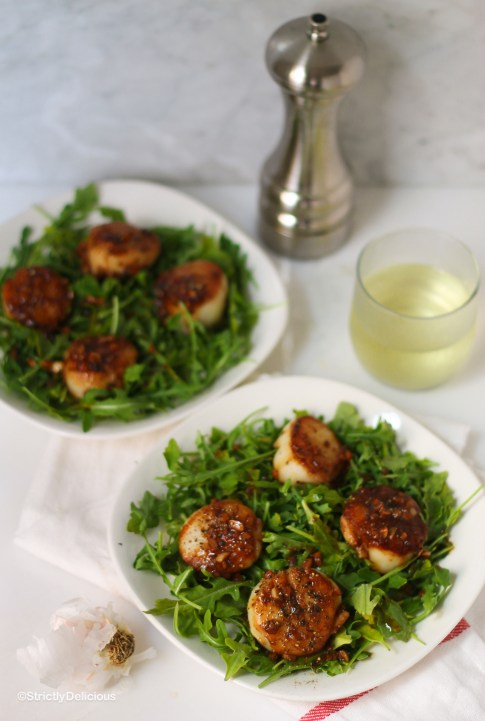 Date Night Scallops over Arugula with White Wine Garlic Sauce | StrictlyDelicious.com