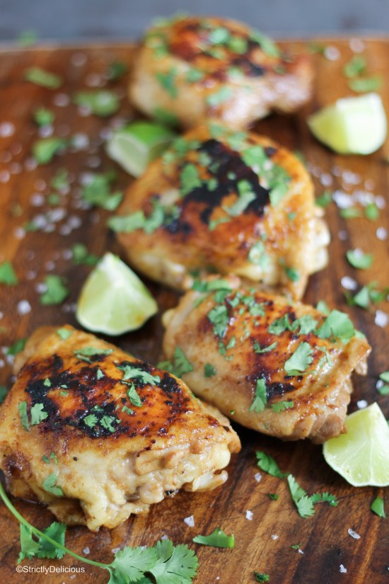 Caribbean Chicken thighs resting on a cutting board | StrictlyDelicious.com