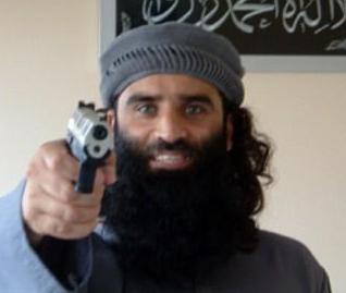 Muslim aiming gun at camera