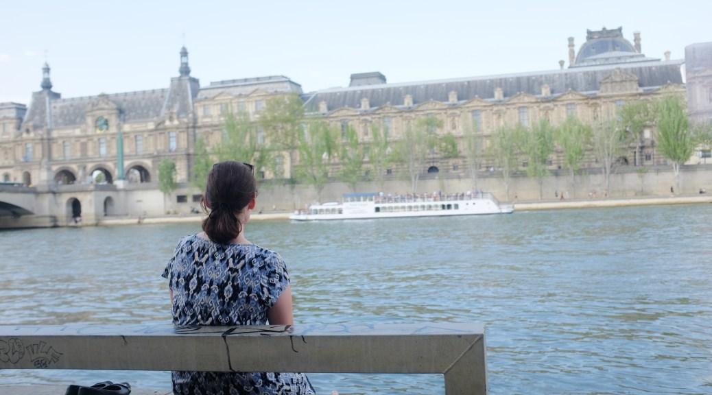 Sitting by the Seine in Paris