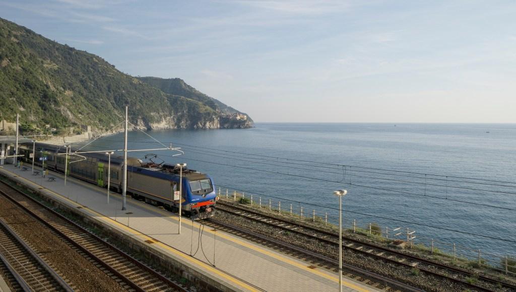 Train passing along the coastline in Cinque Terre Italy