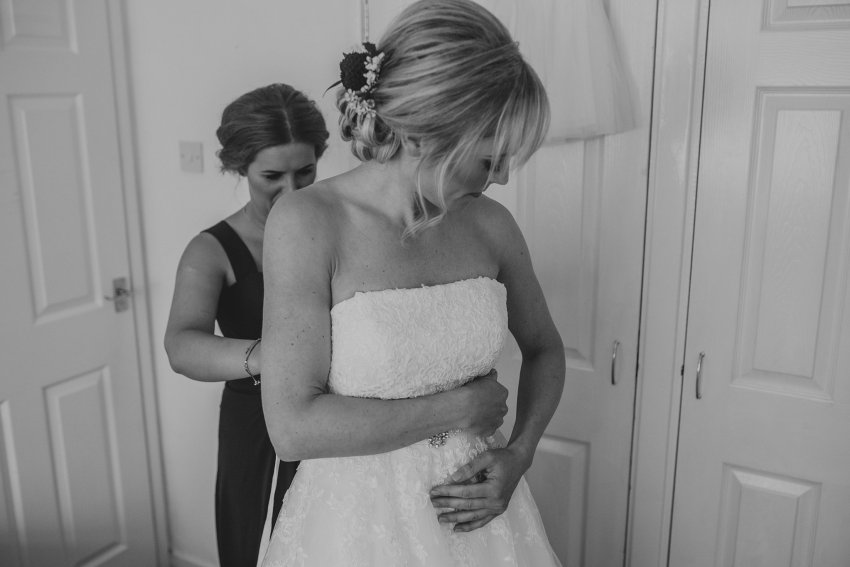 bride getting into dress