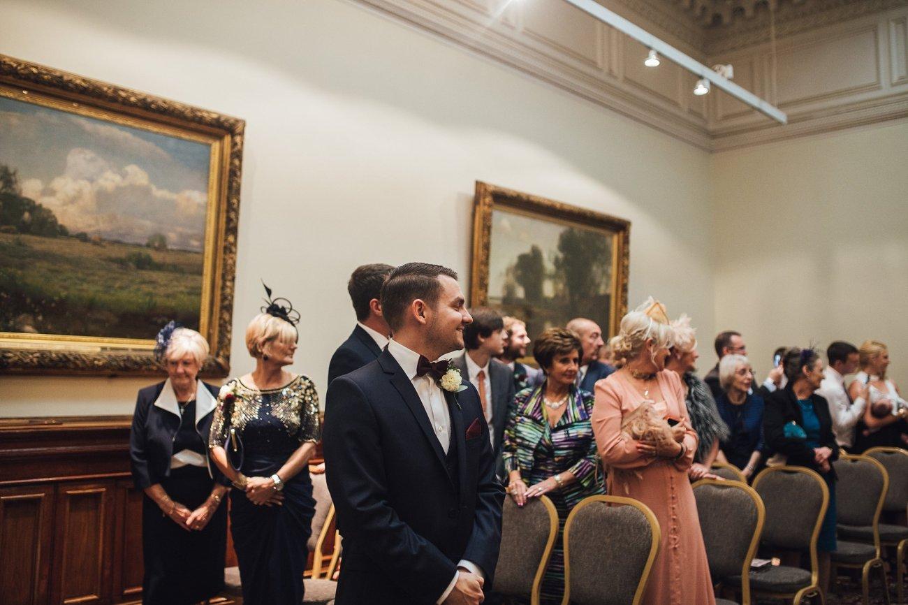 groom looks back