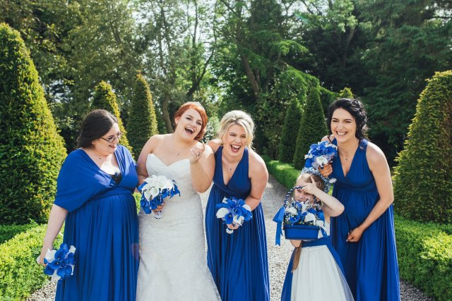 bride and bridesmaids enjoying themselves