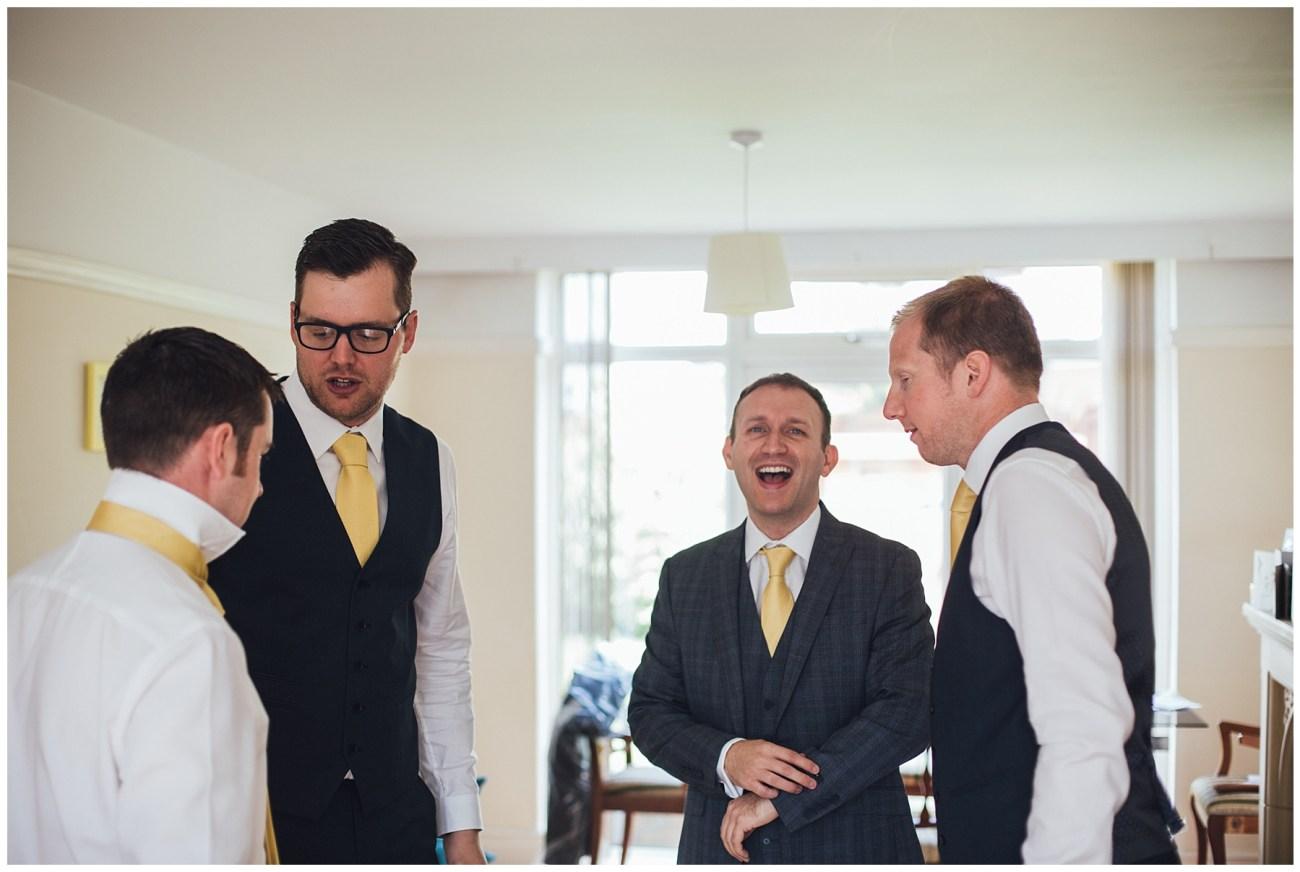 groomsmen laighing