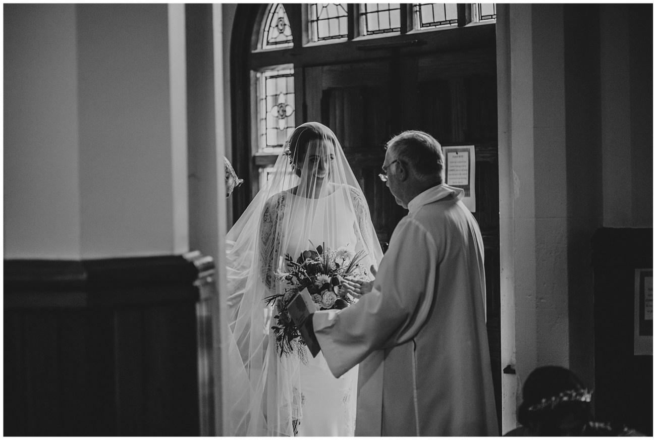 priest greeting bride