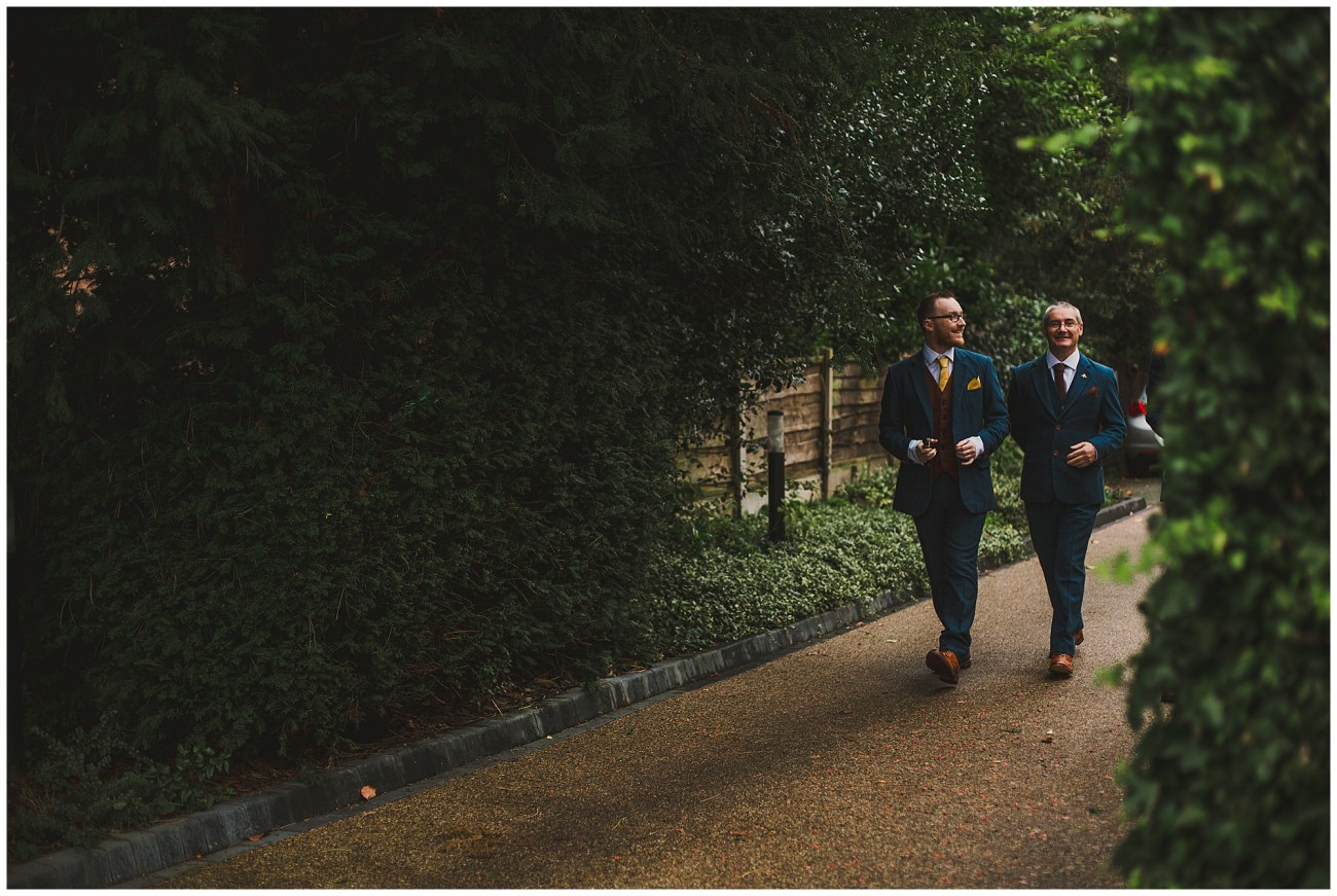 groom and father walking