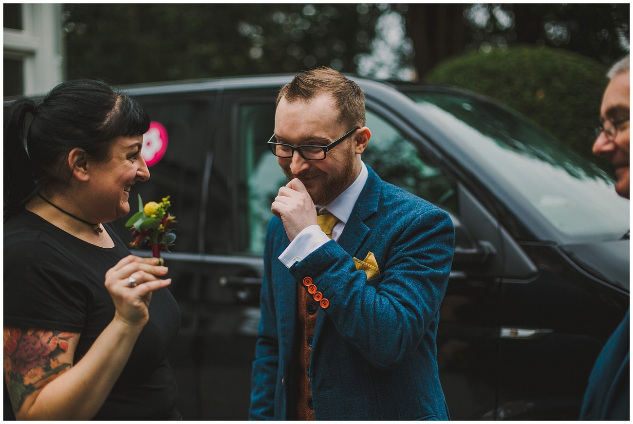 groom receiving buttonhole