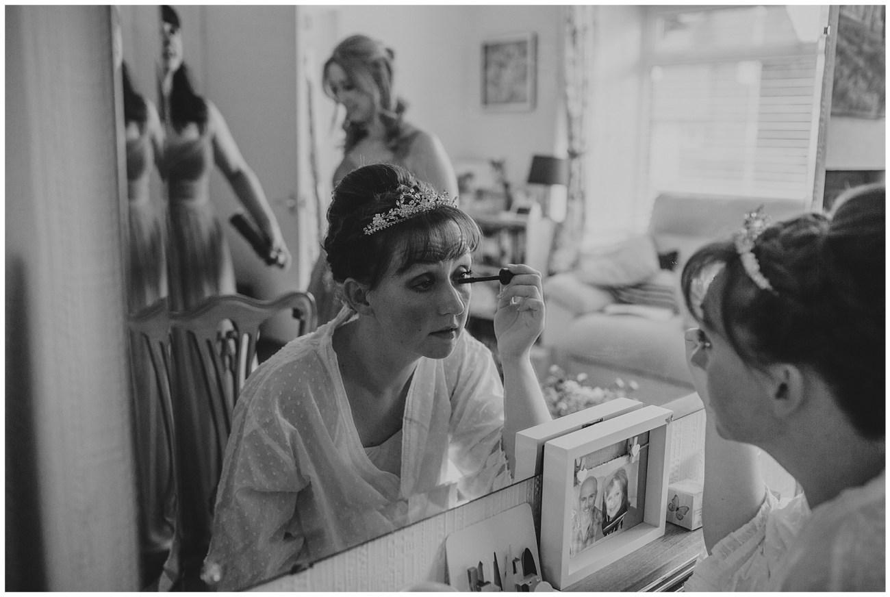 bride applying mascara