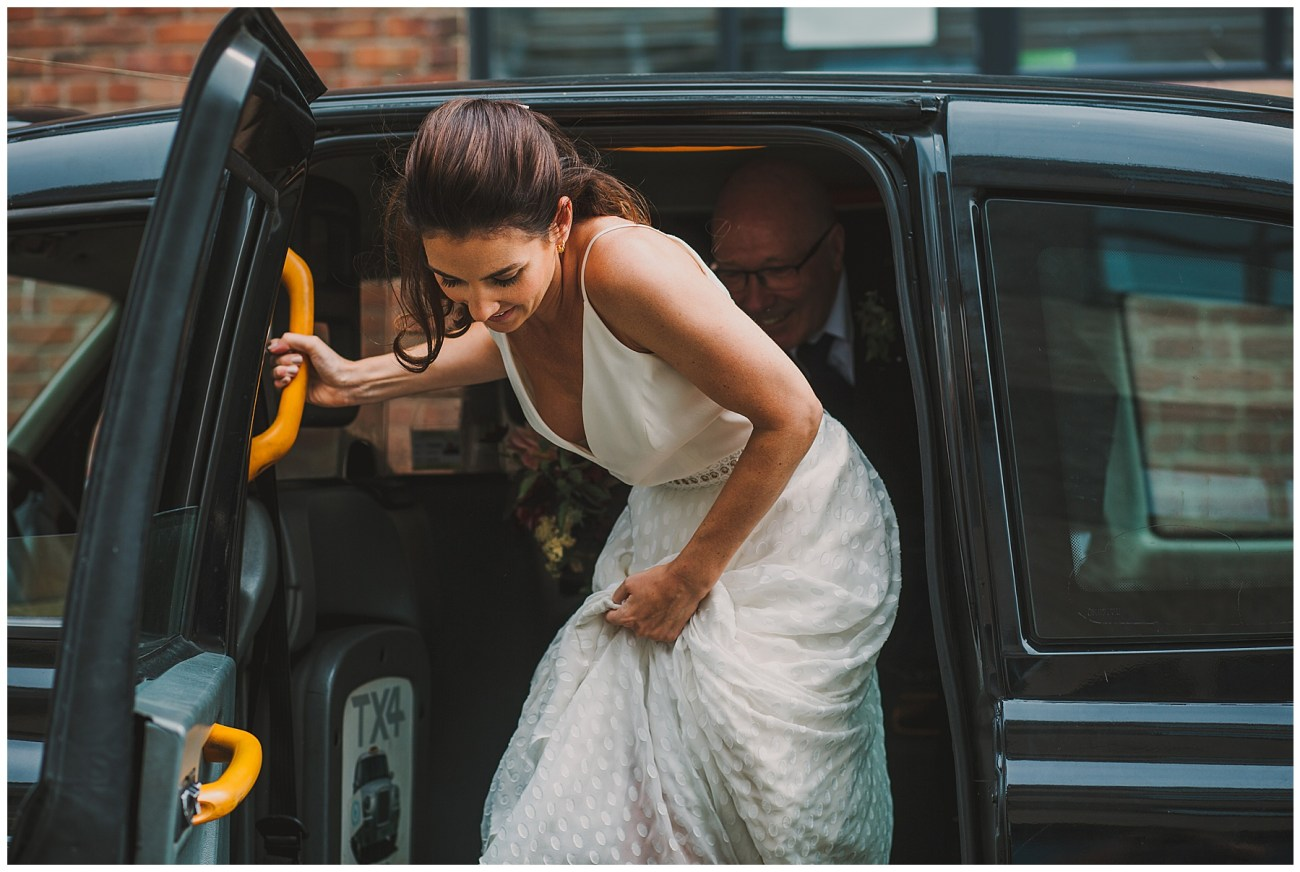 bride leaving black cab