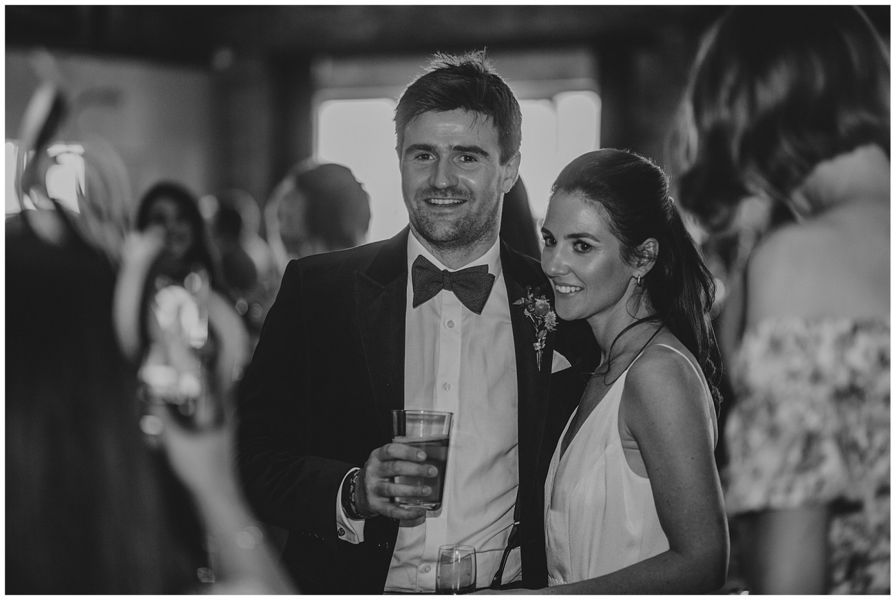 bride and groom smiling in black and white