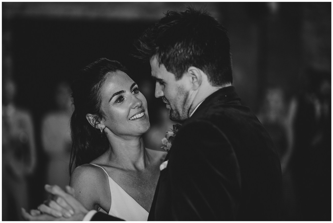 bride and groom looking at each other while dancing