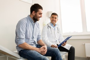 patient talking to urologist about blood in urine