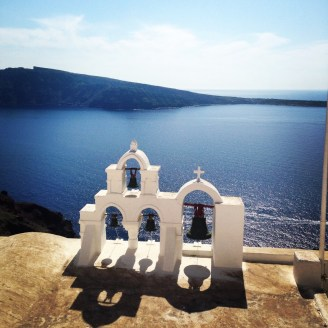 "First Place, A Sense of Place: Jane Swingle, Santorini, Greece. ""Les Cloches: I spent a week on Santorini during a break from studying in France (hence the title of the photo – 'The Bells' in French), and it exceeded every expectation. The island is one of those rare places that must be experienced firsthand to really understand what makes it special. It isn't easy to capture the breathtaking 'sense of place' on Santorini, but I'm happy to say this photo came close."""