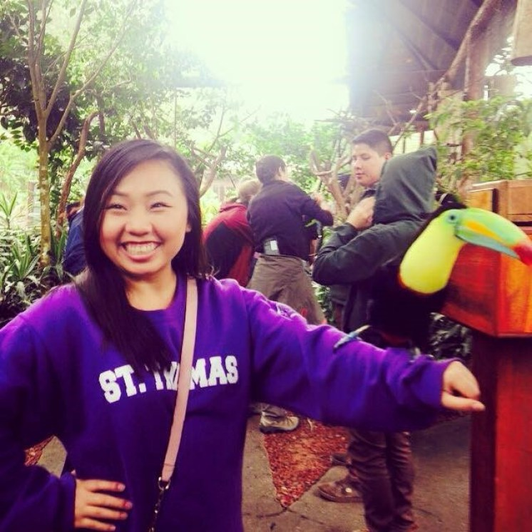 "Honorable Mention, Tommies Abroad: Samantha Yang, Costa Rica. ""A brave Tommie with the country's most cherished animal: Costa Rica is a beautiful country filled with so many animals; however, the most colorful and beautiful animal is their national bird, the toucan. As I was waiting in line to get the chance to have the toucan on my arm, I was jumping in excitement because was so impatient. The moment the bird was set onto my arm I was so happy, I smiled so big and I almost forgot to take a picture, but I did because moments like those don't last forever."""