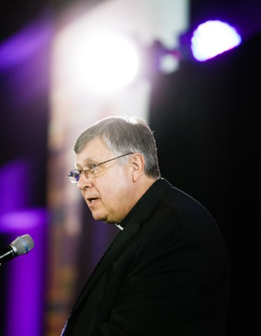 Vice president for mission Fr. Larry Snyder speaks at the brand launch event.