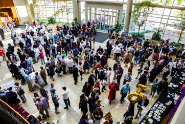 New graduates and family members fill the Schulze Grand Atrium of the School of Law following the School of Law Commencement ceremony May 13, 2017.