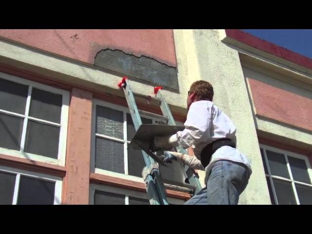 Advanced ladder work using hawk and trowel for stucco fixes