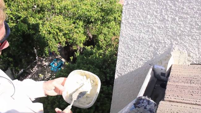 Repairing Missing Stucco with caulking, then matching stucco texture